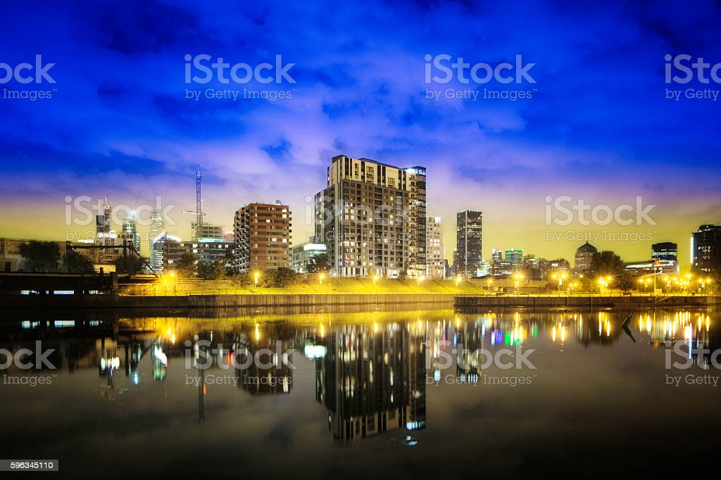 Montreal Griffintown skyline at night with reflection in water stock photo