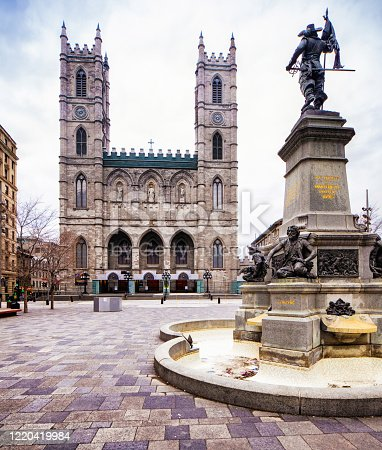 istock Montreal Notre-Dame cathedral with Maisonneuve Monument in the foreground 1220419984