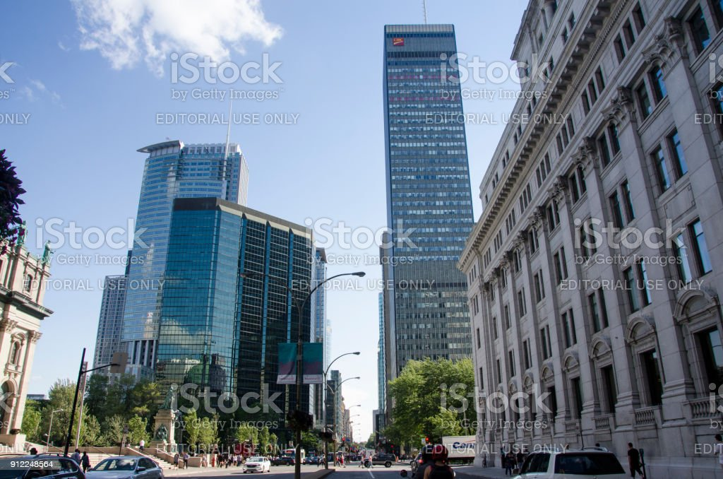 Montreal, Quebec, Canada - 18 July 2016 - Different Syle of buildings (BANK CIBC) in downtown in Montreal in summertime. Canadian lifestyle with cars, people and skyscapers stock photo