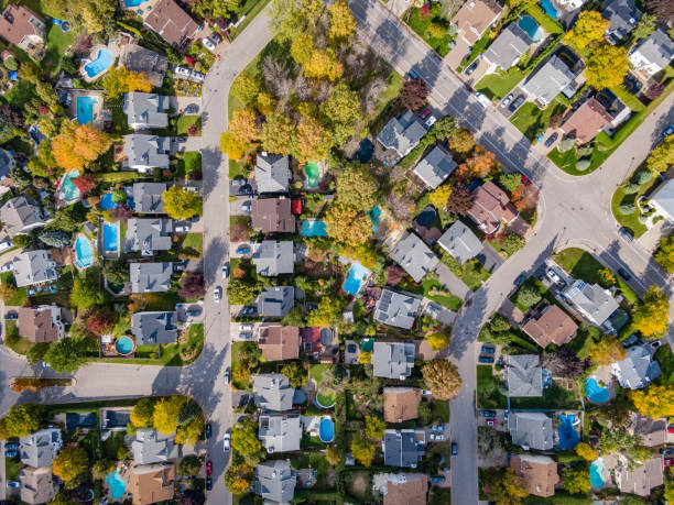 Montreal, Quebec, Canada, Aerial Top Down View of Family Homes in Residential Neighbourhood During Fall Season stock photo