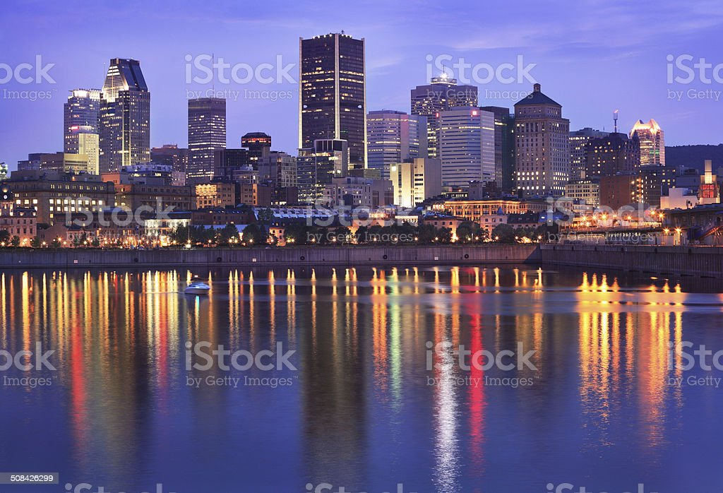 Montreal skyline at dusk and St Lawrence River stock photo