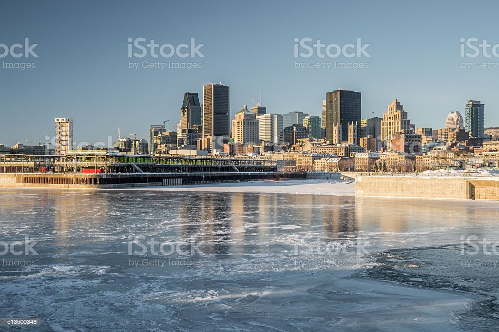Montreal skyline in winter, with frozen St-Lawrence river stock photo