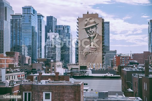 September 15th 2018,Montreal,Canada:Montreal's skyline with the downtown skyscrapers and the Leonard Cohen homage mural.Montreal is the birth place of Leonard Cohen.