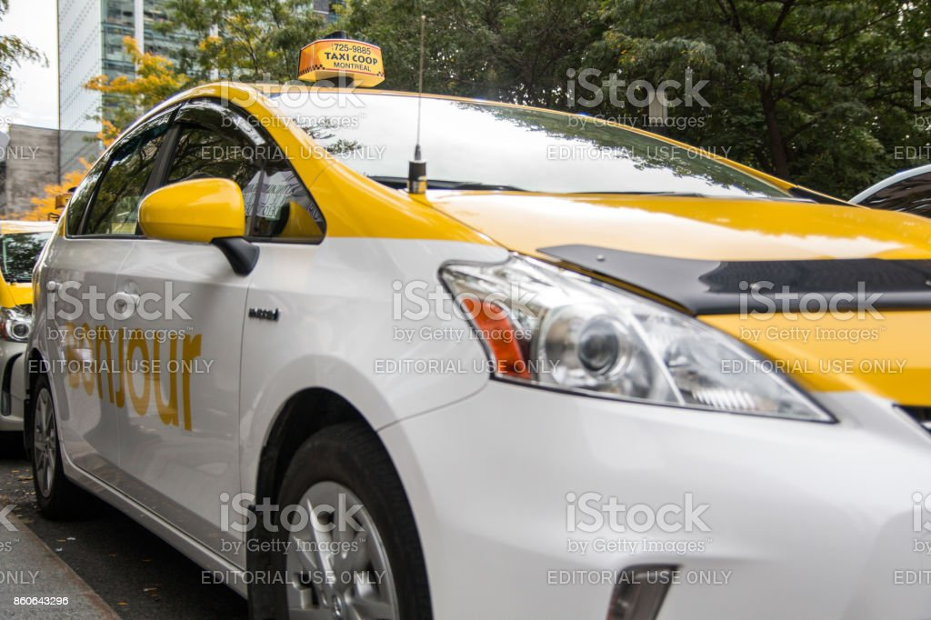Montreal taxi with yellow Bonjour logo stock photo