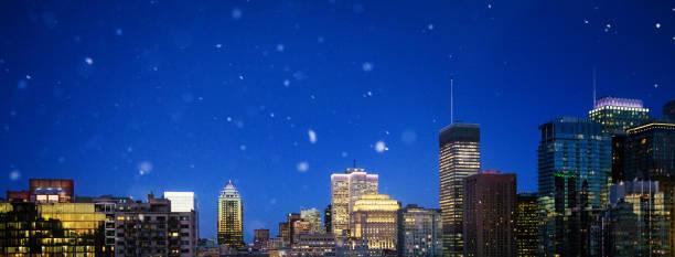 Montreal Winter skyline at night panorama with falling snow stock photo