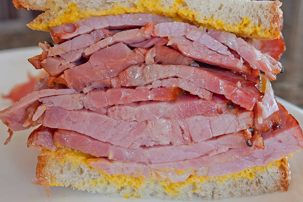 montreal-style smoked meat sandwich - pastrami stock pictures, royalty-free photos & images