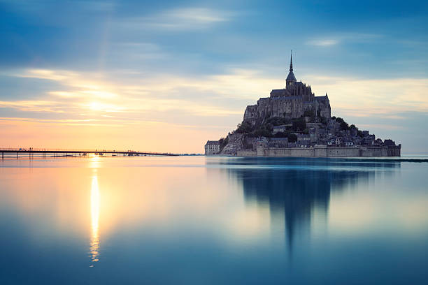 Mont-Saint-Michel at sunset Mont-Saint-Michel at sunset, France, Europe. manche stock pictures, royalty-free photos & images