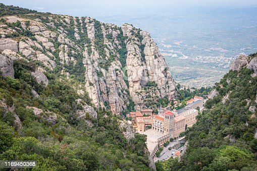 Barcelona, Catalonia, Spain - 17 July 2019: The Montserrat Monastery in Barcelona in summer at the sunset. A lot of pilgrims go every day to visit the Black Madonna of Montserrat. The picture has been taken from the top of the mountain in the Pla de les Taràntules.