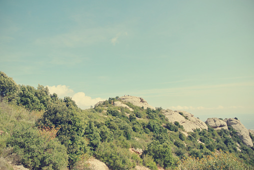 Montserrat mountain, Catalonia, on a sunny afternoon; retro style