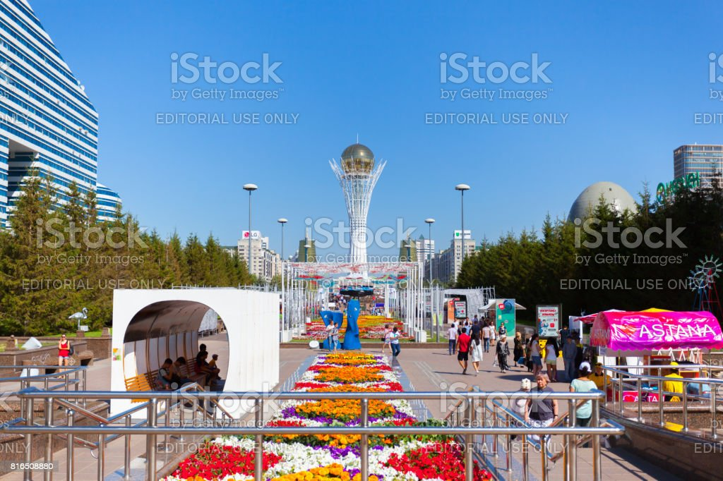 Monument Baiterek and cars on road in city Astana, capital Kazakhstan. stock photo