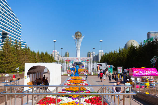 Monument Baiterek and cars on road in city Astana, capital Kazakhstan. stock photo