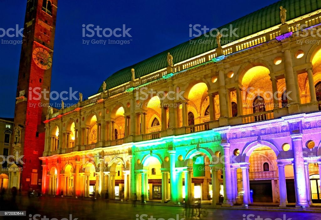 monument called Basilica Palladiana with multi colored lights in the downtown of Vicenza in Italy - foto stock