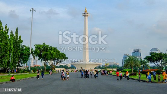 Jakarta, Indonesia. April 14 2017: A number of tourists at the National Monument area, Jakarta, Indonesia. Monas is an icon of the capital city of Jakarta.