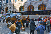New York,USA -September 08,2017 : Monument of Charging Bull Financial on Broadway, near Wall Street in the New York with people and tourists.