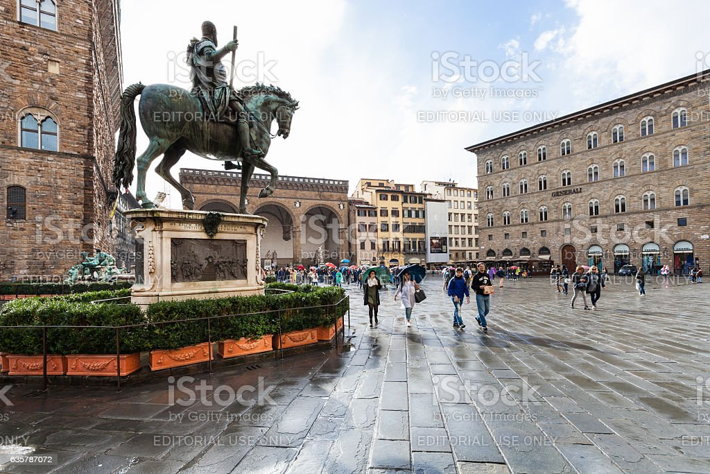 monument of Cosimo I and tourists on Piazza stock photo