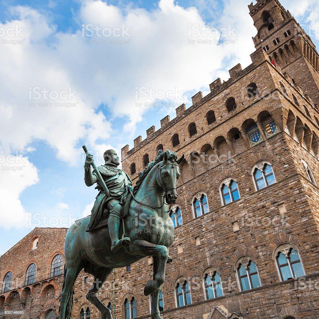 Monument of Cosimo I and wall of Palazzo Vecchio stock photo