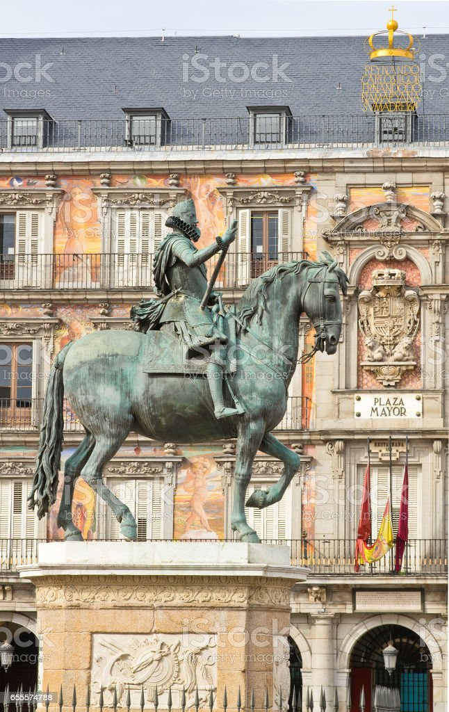 Monument of Philip III on Plaza Mayor with Bakery house on background (Casa de la Panaderia) in Madrid, Spain stock photo