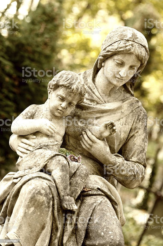 Monument of the woman with child on a cemetery royalty-free stock photo