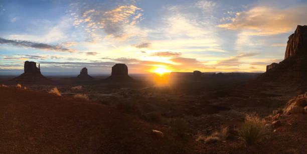monument panorama sunset - native american reservation stock photos and pictures