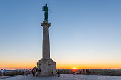 Belgrade, Serbia-August 27, 2020: Monument sculpture of the Belgrade Victor (serbian: Pobednik) made of bronze. The monument in a park in Kalemegdan fortress, made in 1928.
