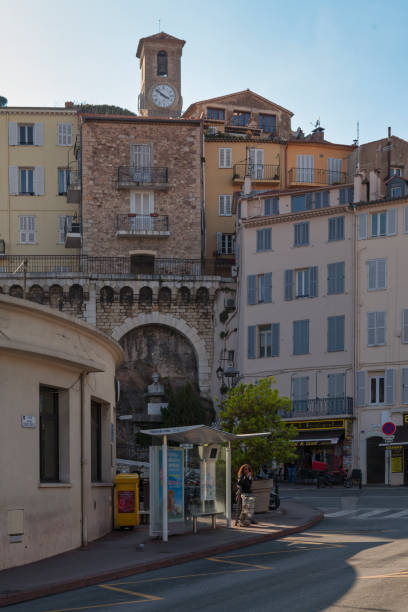 Monument to Donat-Joseph Méro and the bell tower of the church of Notre-Dame d'Espérance in Cannes stock photo