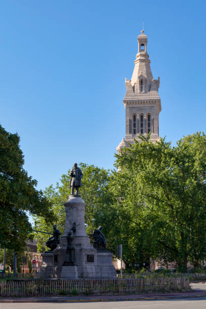 Monument to Louis Pasteur and the church of Saint-Michel in Lille stock photo