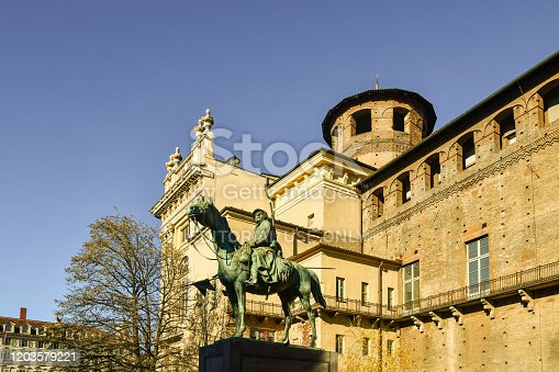 istock Monument to the Knights of Italy (1923) by the sculptor Pietro Canonica on one side of Palazzo Madama palace and Casaforte of Acaja fortress in city centre of Turin, Piedmont, Italy 1203579221
