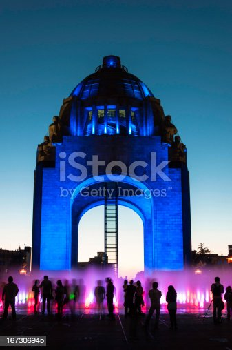 Monumento a la Revolución Mexicana, built in Mexico City in 1936. People watching the show of water and lights at dusk.