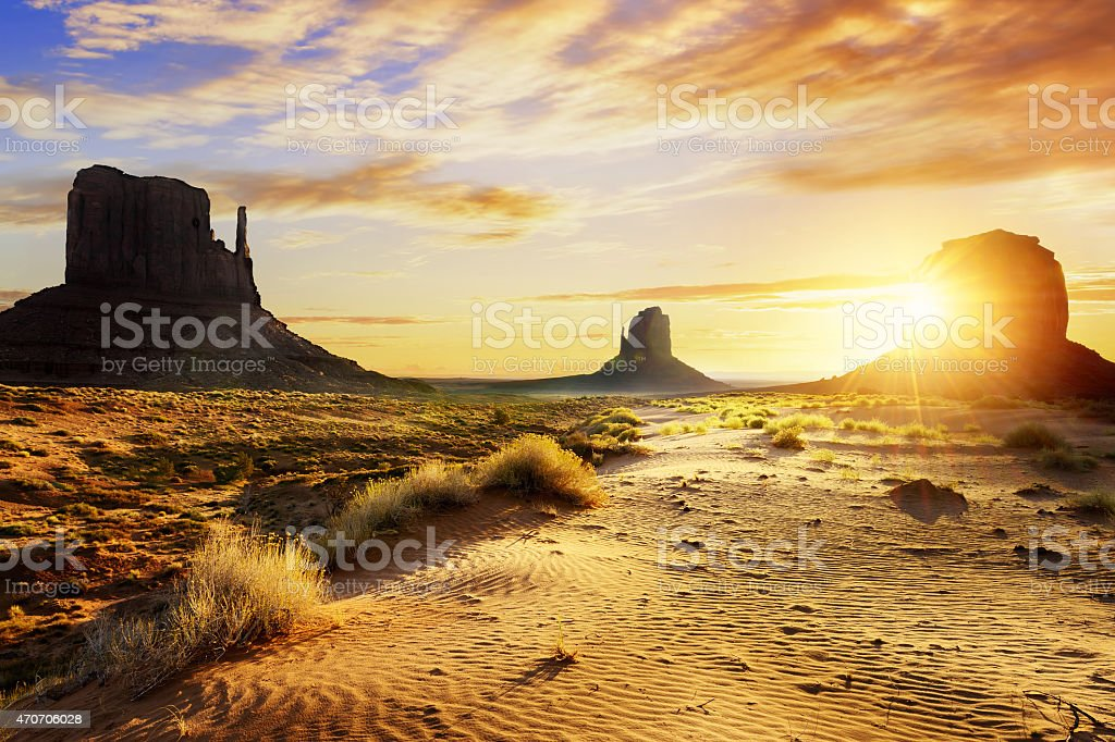 Monument Valley and surrounding desert as seen at sunset stock photo