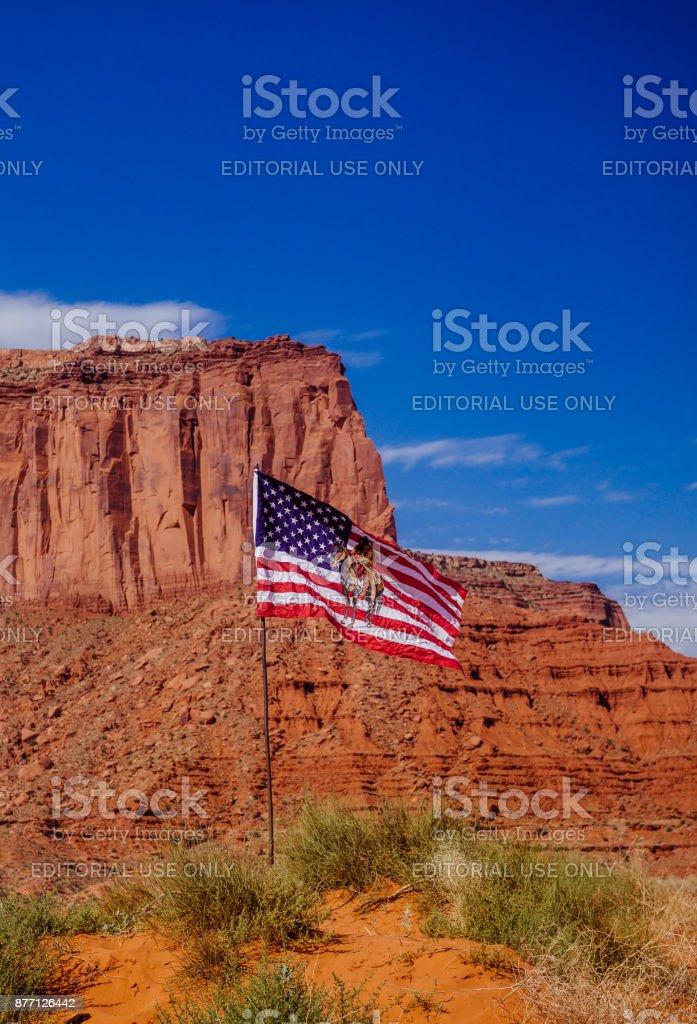 Monument Valley and the Navajo flag. History of the USA stock photo