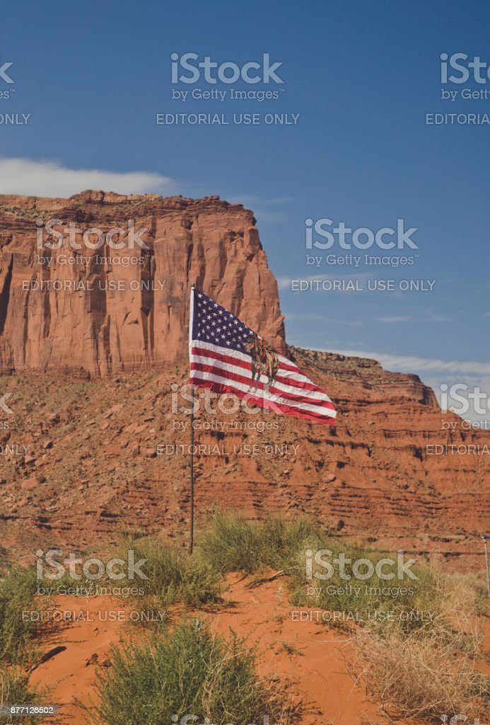Monument Valley and the Navajo flag. History of the Wild West USA stock photo