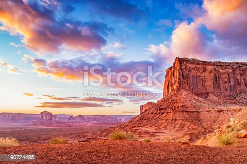Stock photograph of buttes and mesas at Monument Valley Arizona USA during a dramatic sunrise.