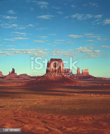 Early evening in Monument Valley with vast sandstone and buttes rising above the valley floor on the Arizona-Utah state line