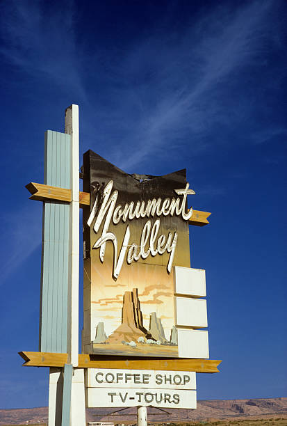 Monument Valley Coffee Shop sign - 1973 A big sign for a tiny coffee shop in Monument Valley, Utah.   hearkencreative stock pictures, royalty-free photos & images