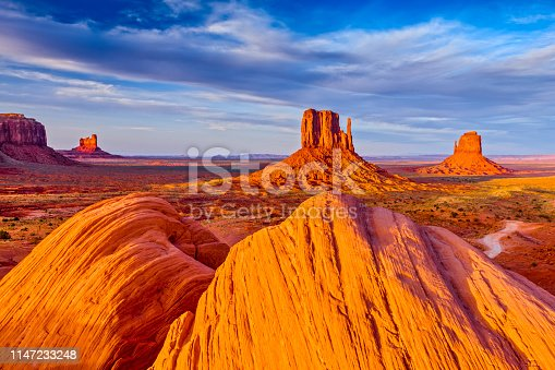 The mittens geologic feature in Monument Valley tribal park in Arizona at sunset
