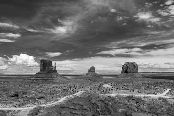 Monument Valley in Black and White The most famous buttes of Monument Valley Tribal Park (East and West Mitten) inside the Navajo Nation Reserve edited in black and white, Arizona and Utah, United States of America a (USA). navajo sandstone formations stock pictures, royalty-free photos & images