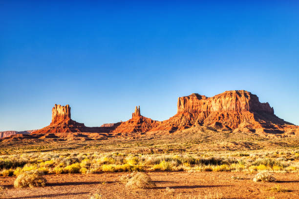 Monument Valley in Navajo National Park during a Sunny Day, Border of Utah and Arizona, USA stock photo