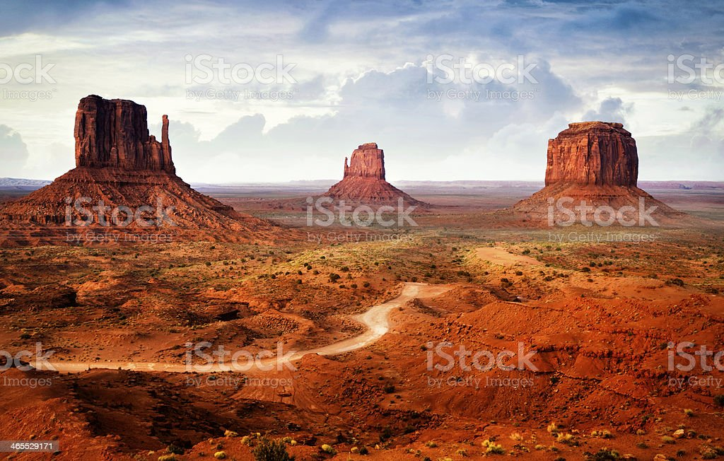 Morning mist at the Mittens in Monument Valley on Navajo land in...