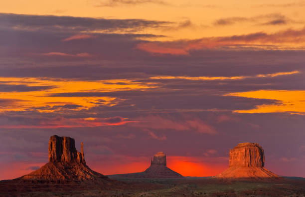 the mittens and merrick butte at sunset - jeff goulden stock photos and pictures