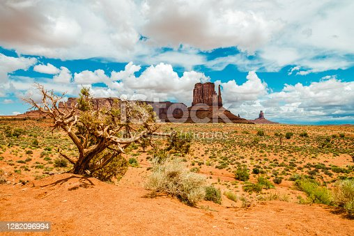 A red-sand desert at Monument Valley on the Arizona-Utah border known for the towering sandstone buttes.