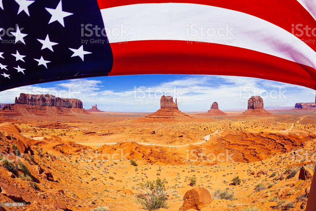 Monument Valley Landscape with American Flag, USA Landmark stock photo