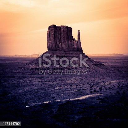 Monument Valley. Classic Wild West landscape. Sunset, toned for the mood. Digital noise added to avoid banding in the sky.