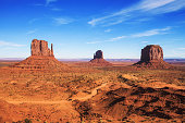Dirt road leading through Monument Valley on the border between Arizona and Utah, USA.