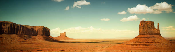 monument valley panorama - wild west stock photos and pictures