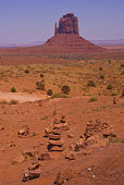 A sweeping vista of sand, buttes and clouds in Monument Valley, Utah.