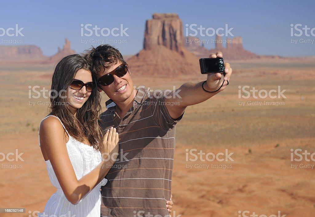 Monument Valley - Tourists taking their Picture (XXXL) royalty-free stock photo