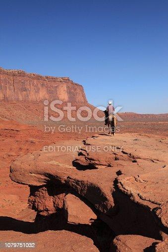 Arizona, USA - September 18, 2018: Western Cowboy sitting on Horseback at Monument Valley Tribal Park Arizona