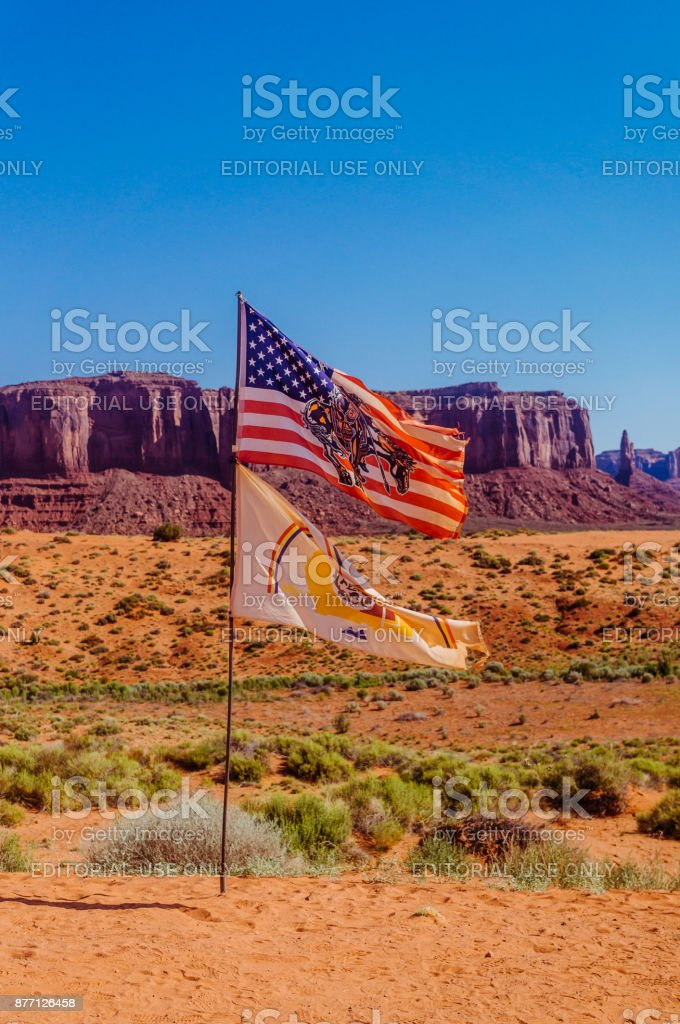 Monument Valley, Utah. Flag of the Navajo on the background of majestic rocks stock photo