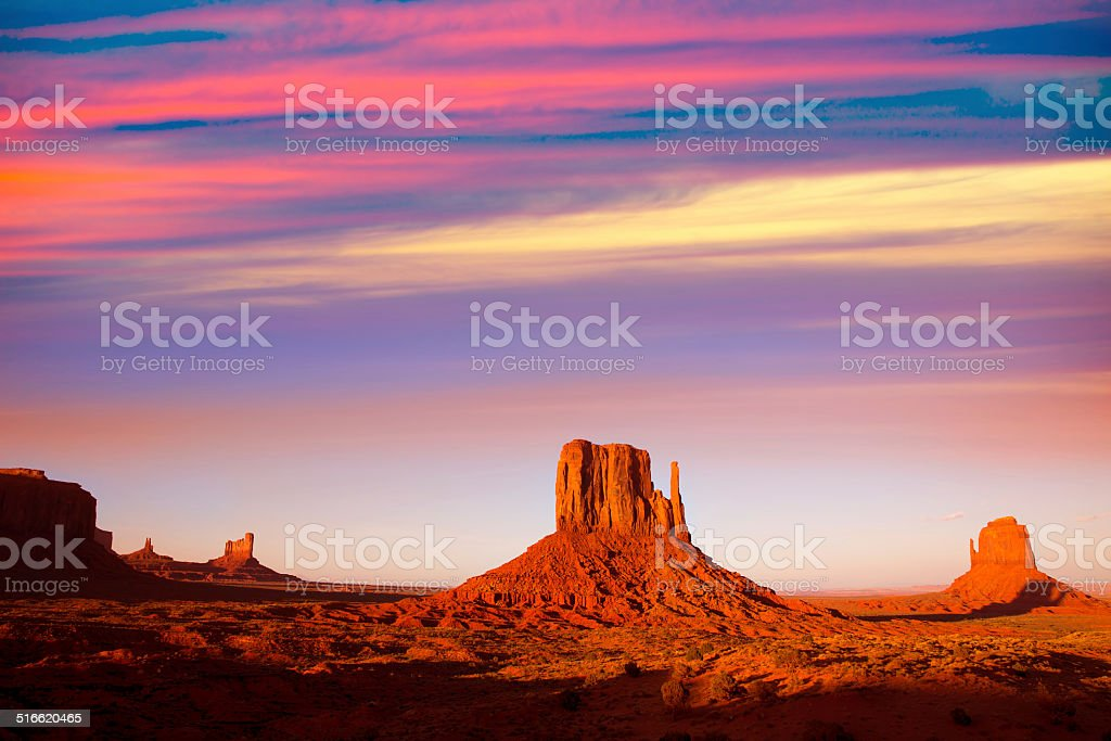 Monument Valley West Mitten and Merrick Butte sunset stock photo