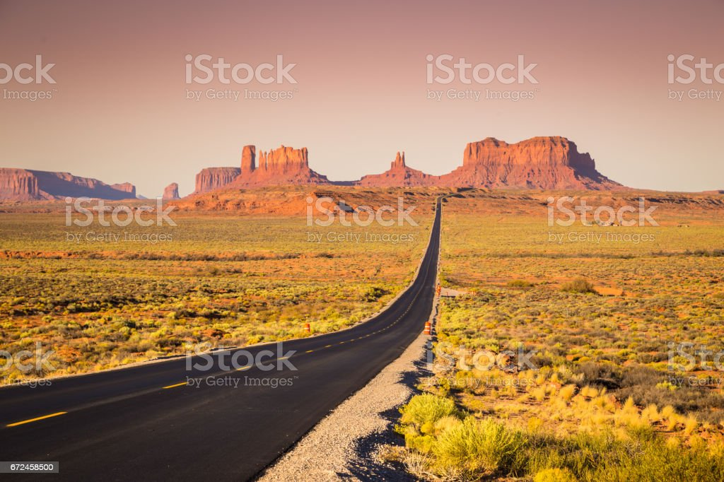 Monument Valley with U.S. Highway 163 at sunset, Utah, USA stock photo